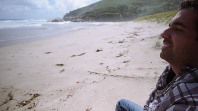 4K footage of a man breathing and seating on the beach, Wilson Promontory, Victoria, Australia