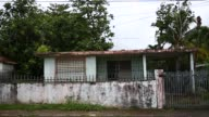 Footage of an abandoned house in the town of Dorado Puerto Rico on July 9 2017 Shots wide shots of abandoned home in frame shot of truck passing in...