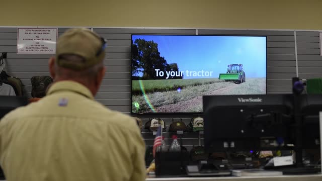 Footage of an employee assisting a customer at the desk at a John Deere Tractor dealership in Waco TX on November 20 2017 Photographer Sergio Flores...