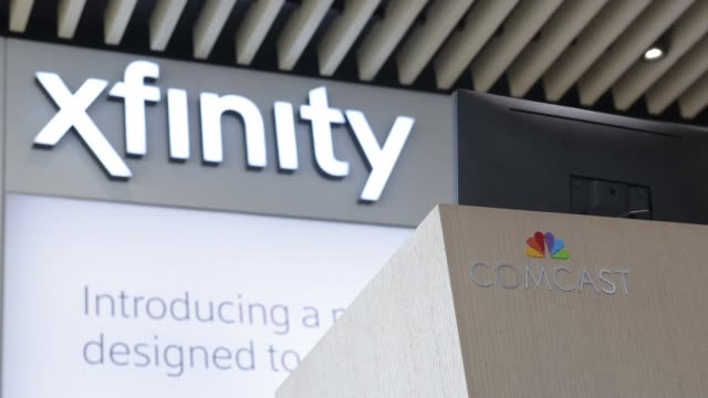 Footage of Comcast's new XFINITY store in King of Prussia PA on July 25 2017 Shots wide tilt down of interior of store with Xfinity signage pan right...