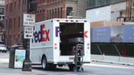 Footage of FedEx truck being loaded up by worker in Chicago IL on September 15 2017 Photographer Christopher Dilts Shots wide shot of FedEx truck...