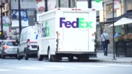 Footage of FedEx worker closing up truck then driving off into the road in Chicago IL on September 15 2017 Photographer Christopher Dilts Shots wide...