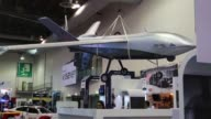 Footage of hanged plane drones Whelen vehicles police uniforms and bulletproof vests on display at the Banamex Convention Center on January 26 2016...