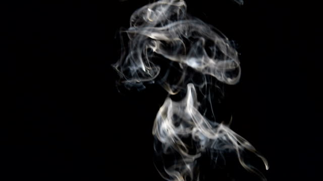 Footage of movement of white smoke on black background