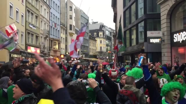 Footage of Northern Ireland fans in the pouring rain in Basel Switzerland ahead of the World Cup Qualifier clash