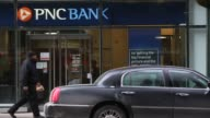 Footage of PNC bank locations in New York NY on January 9 2017 Shots wide pan right of PNC Bank location tight static shot of PNC Bank and doors...