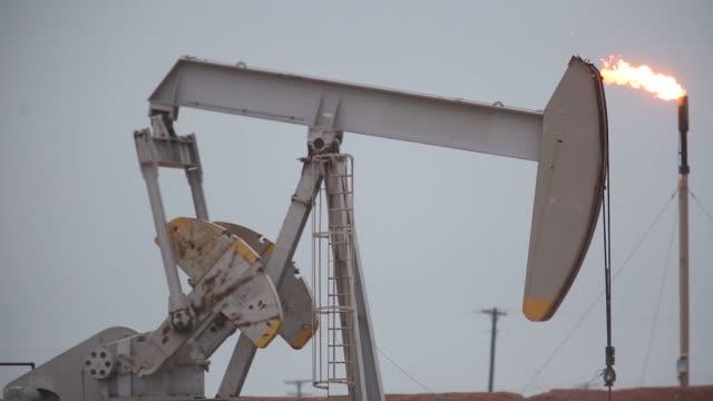 Footage of pumpjacks in an oil field surrounding Midland Texas US on Wednesday Nov 8 2017 Photographer Luke Sharrett Shots wide shot of pumpjack...