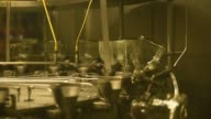 Footage of Tequila Patron bottling process in Atotonilco Jalisco Mexico on April 5 2017 Shots close up of many tequila bottles ready to be filled /...