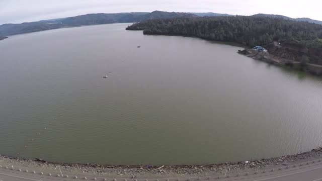 Footage of the bird's eye view of the leaking Oroville dam as well as the the area of the water evacuation efforts take place in Oroville California...