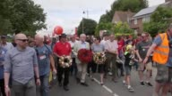 Footage of the Labour leader Jeremy Corbyn taking part in a procession through the village of Tolpuddle and laying a wreath The procession is part of...