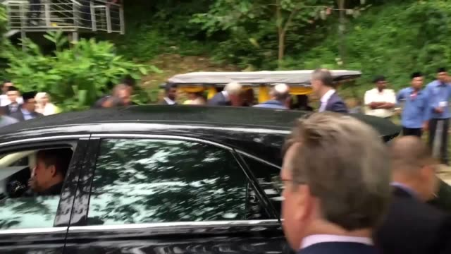Footage of the Prince of Wales as he visits the habitat Malayan tigers live in when as he is taken on a boat trip in the Royal Belum State Park in...