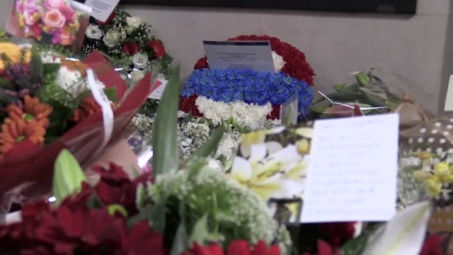 Footage of victims' families and survivors at a memorial service for the 31 people who died in the King's Cross fire 30 years ago Includes shots of...