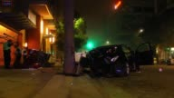 25 A car came speeding off the 163 highway into downtown San Diego slammed into a parked car flipped and landed leaning against the Ten Fifty B...