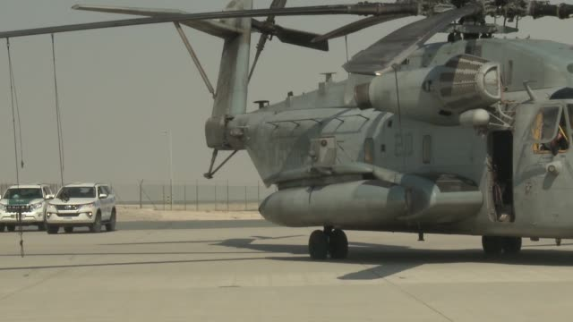 Footage showing Marine Central Command CH53 Super Stallion helicopter being staged for the 2017 Dubai Air Show Other aircraft being staged for the...