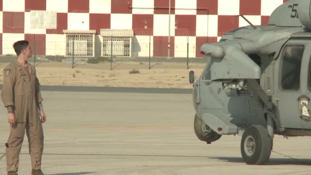 Footage showing Navy Central Command Sikorsky MH60 Seahawk helicopter being staged for the 2017 Dubai Air Show Other aircraft being staged for the...