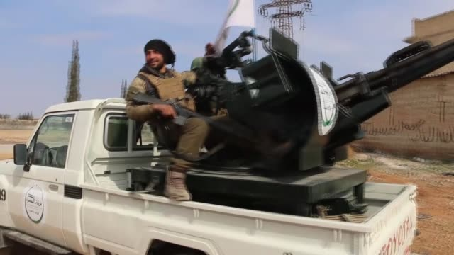 Footage shows fighters of Free Syrian Army backed by Turkish Armed Forces engage DAESH terrorists in the streets of AlBab town of Aleppo Syria after...