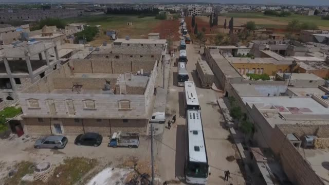 Footage taken by drone shows buses carry Syrian civilians and opponent forces members evacuated from AlWaer district of Homs arrive at AlBab town of...