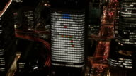Footage taken from a helicopter shows the gigantic Christmas tree and snowman lighting up the nights in Osaka's Nakanoshima commercial district Video...