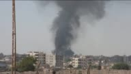 Footage taken in Nusaybin of Mardin southeastern Turkey shows smoke rises AlQamishli district of alHasakah in Syria on July 27 2016 after severe...
