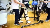 Footage taken inside the Ibaraki Prefectural University of Health Sciences Hospital in Ami Ibaraki Prefecture shows the wearable cyborgtype robot HAL...