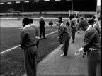 Benfica train for 2nd semifinal of European cup V Spurs ENGLAND White Hart Lane Run past CS Manager Bela Guttman MS CU One breathing CS Pan up...