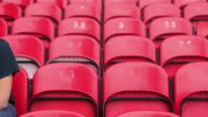 Football fan in empty stadium looking depressed