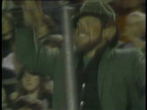 1983 MS Football fan wearing Leprechaun costume dancing jig and pointing shillelagh during USFL game / USA