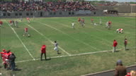 WS HA PAN Football game and audience clapping and cheering on bleachers