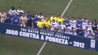 Football icons Ronaldo and Zinedine Zidane lead two star teams including Cafu Lucas Neymar Romario Bebeto and Karembeu in a charity match against...