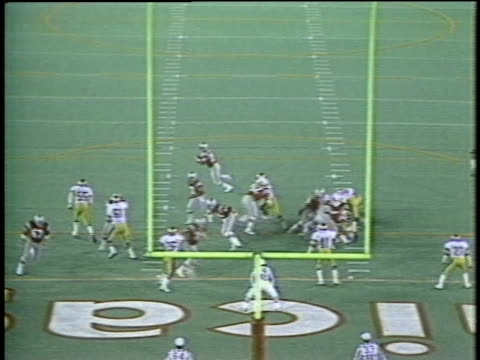 1983 HA WS Football player Frank Corral of USFL team Chicago Blitz scoring and spiking ball on field during game against Arizona Wranglers / USA