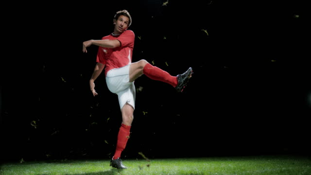 SLO MO Football player kicking the ball