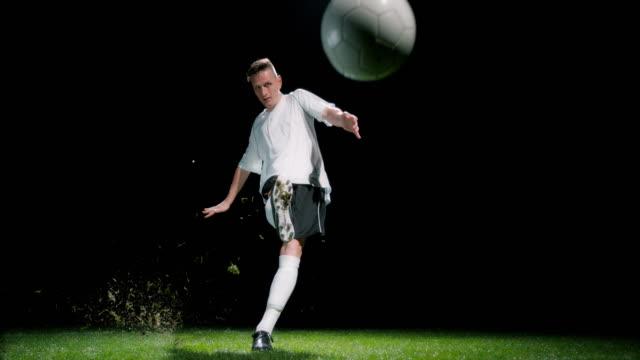 SLO MO Football player taking a penalty kick