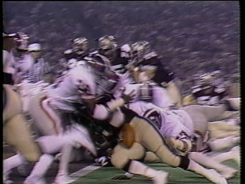 1984 SLO MO MS Football players fumbling ball along goal line during game between USFL teams Pittsburgh Maulers and Michigan Panthers / HA WS Players jumping on ball and tackling each other near referee / Pontiac, Michigan, USA