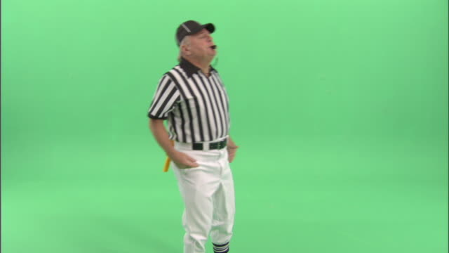 MS, Football referee blowing whistle in studio