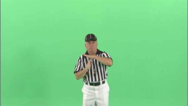 MS, Football referee signalling television or radio time out / studio, portrait