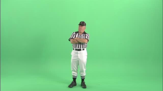 WS, Football referee standing in studio, portrait