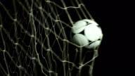 Football / Soccer ball into net - Scoring a Goal