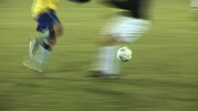Football / Soccer Match live Sports action Dribbling the ball