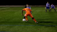Football / Soccer player tackling in a match