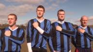 Football / Soccer team singing national anthem -DOLLY