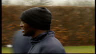 High Wycombe Adams Park EXT Wycombe Wanderers football team training / players training in rain / PAN around Wycombe Wanderers Football Stadium /...