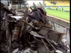 Wolves Ground attacked again ENGLAND Wolverhampton Molineux BV Men boarding up windows at ground after arson attack CBV Ditto TMS Damaged furniture...