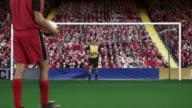 Footballer and goalkeeper saving a penalty