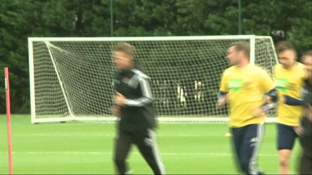 Footballer Andy Carroll escapes gunmen R23101410 Players along at West Ham training ground