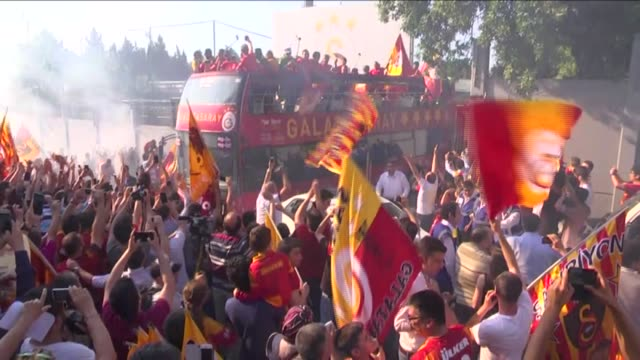 Footballers of Galatasaray which become the champion of Turkish Spor Toto Super League celebrate during a parade in an open top bus from Metin Oktay...