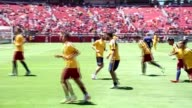 Footballers warm up before the 2015 International Champions Cup match between FC Barcelona and Manchester United at Levi's Stadium in Santa Clara...