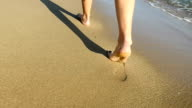 Footprints on the Mediterranean beach