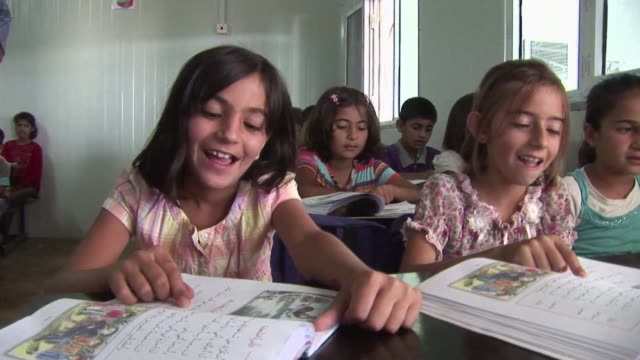 For Syrian kurds the Domiz camp in Iraqi Kurdistan can offer wildly different fates VOICED For Syrian Kurds camp offers wildly on June 18 2013 in...