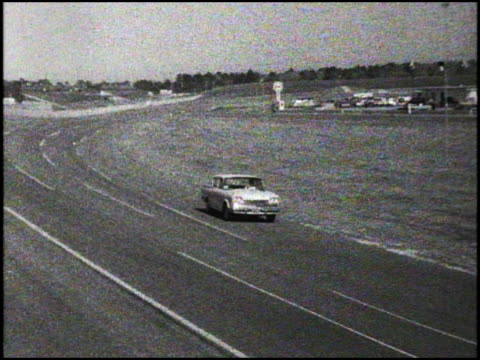 Ford Falcon rounding a Daytona Speedway turn during the 1960 Pure Oil Economy Trials / WS TRACKING SHOT of AMC Rambler Six Deluxe rounding the turn...