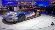 WS Ford GT revolving on turntable / CU hole in carbon fiber fender ZO MS driver side profile of front end / CU on hood / CU Ford logo Powered by...